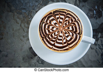 Cup of mocha coffee on table