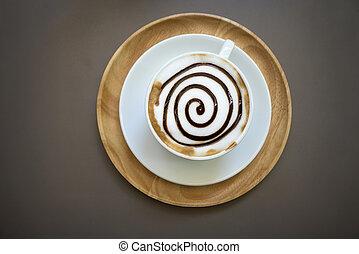 Cup of mocha coffee on wood table