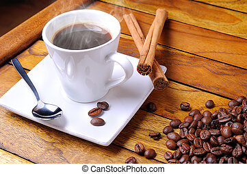 Cup of steaming coffee on a brown table