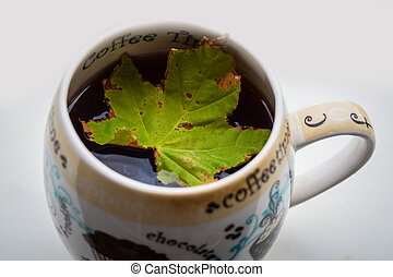cup of tea and autumn leaves