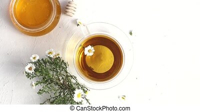 Cup of tea and bowl of honey - From above view of glass cup...