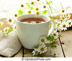 cup of tea and chamomile flowers