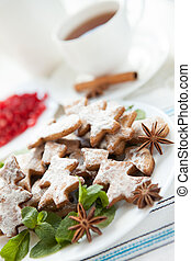 Cup of tea and Christmas cookies vertical composition