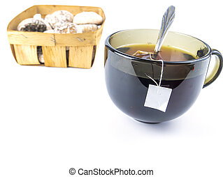 Cup of tea and cookies on a white background with free space for text.
