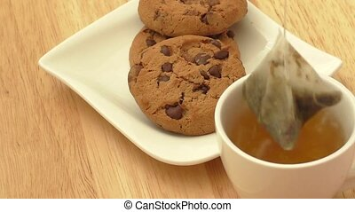 Cup of tea and cookies - Cup of tea with tea bag and cookies