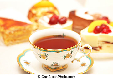 Cup of tea and various cakes -shallow DOF