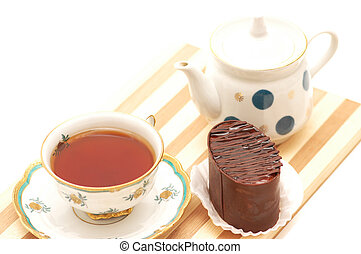 Cup of tea, chocolate cake  and pot