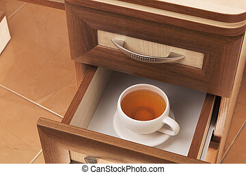 cup of tea in desk drawer