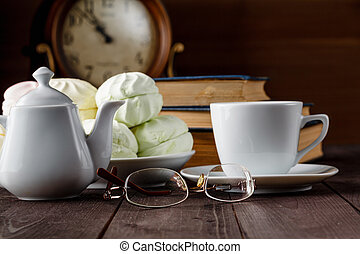 Cup of tea near old books