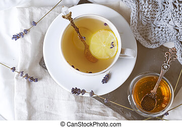 Cup of tea on a bed