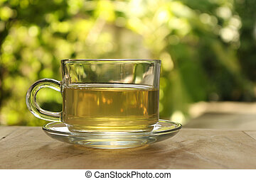Cup of tea on a blurred background of nature.