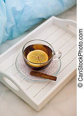 Cup of tea on the bed