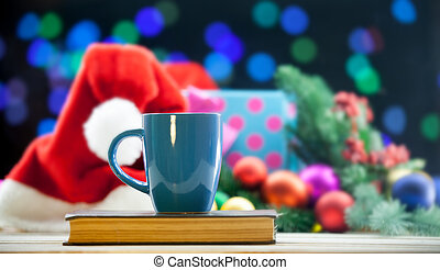 Cup of tea or coffee on a book