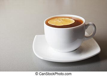 Cup of Tea with lemon slice on gray table