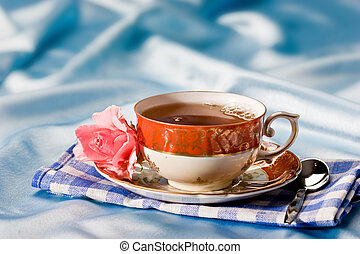 cup of tea with flower over azure