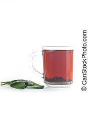 cup of tea - Full glass cup of tea and greens  leaves