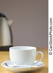 Cup of tea with a kettle