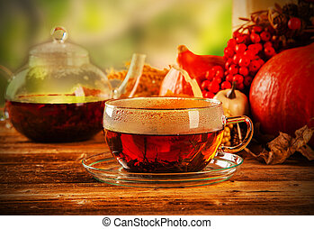 Cup of tea with autumn leaves with season vegetable on ...