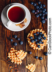Cup of Tea with Belgian Waffles and Blueberries.