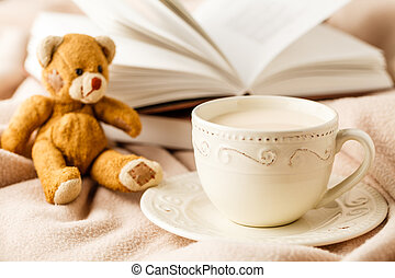 Cup of tea with book on table close-up