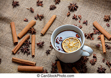 Cup of tea with cinnamon and star anise ingredients