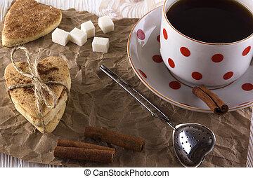Cup of tea with cinnamon cookies.
