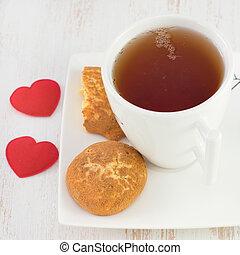 cup of tea with cinnamon cookies
