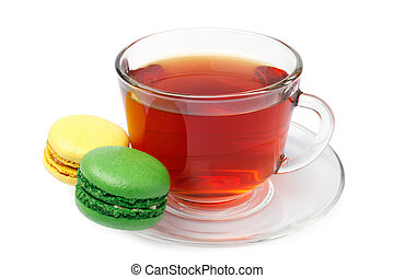 Cup of tea with colorful french macaroons