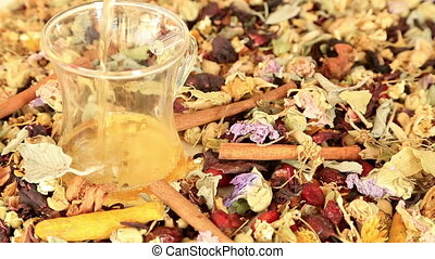 Cup of tea with different kind of healing herbs