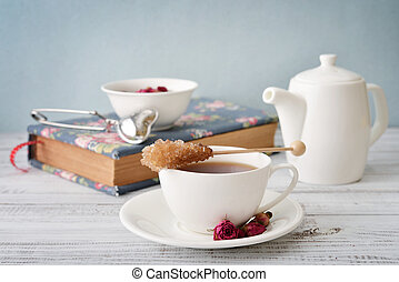Cup of tea with dry rose buds