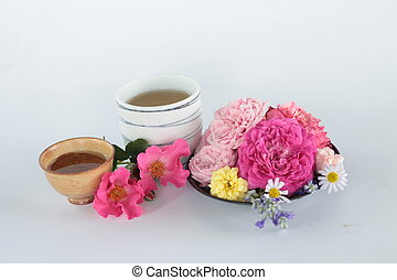 Cup of tea with flower.