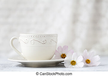 cup of tea with flower on white