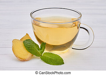Cup of tea with ginger and mint.