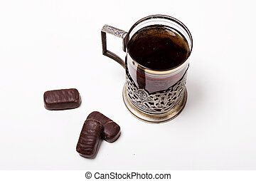 Cup of tea with glass-holder and candy
