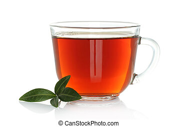 Cup of tea with green leaves