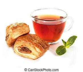 Cup of tea with homemade bun