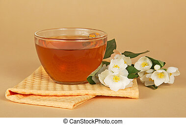 Cup of tea with jasmine branch