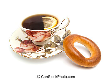 cup of tea with Lemon and bagel
