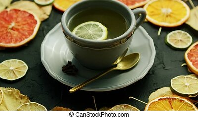 Cup of tea with lemon and spoon - From above view of cup of...