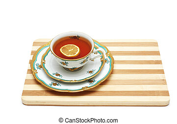 Cup of tea with lemon isolated on the white