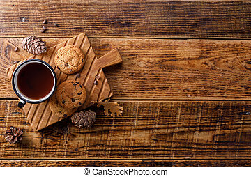 Cup of tea with oatmeal cookies on a wooden background. Flat lay. Space bar under your text.
