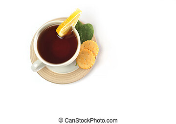 cup of tea with lemon, pastry and sugar