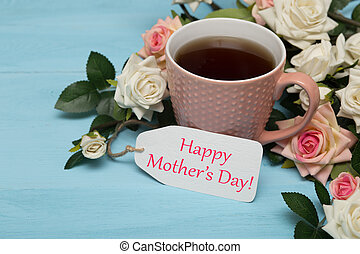 Cup of tea with roses and mothers day tag