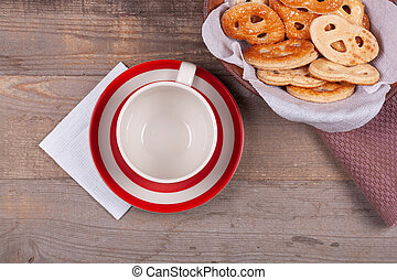 Cup of tea with sweet cookies on wooden background