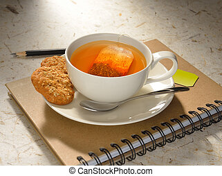 Cup of tea with tea bag and cookies on notebook