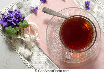 cup of tea with violets