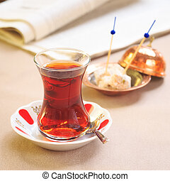 Cup of turkish tea with locum on oriental plate. Concept of ...