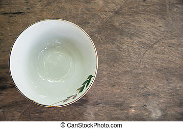 Cup on wood background.