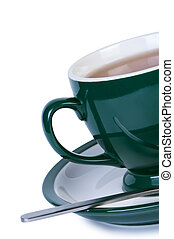 Cup tea on saucer with spoon isolated.