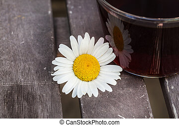 Cup tea with chamomile on